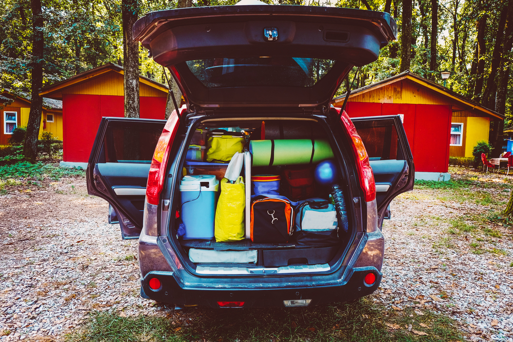 An open car trunk full of supplies for a trip