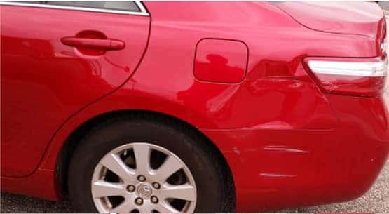A car that was damaged near the taillight in an accident